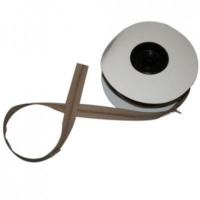 Fermeture à glissière beige 6 mm, les 25 mètres